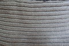 Wales on grey handmade knitwork from above. Wales on grey hand made knitwork from above Stock Photos