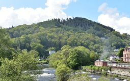 Wales, Llangollen.  The river Dee on a bight spring day. North Wales, Denbighshire, the historic town of Llangollen.  A bight spring day.  Wooded hillsides rise royalty free stock image
