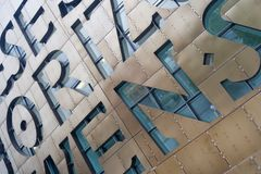 Wales Millennium Centre 6. Reflections in the letter shaped galss windows of Wales new flagship arts centre in the capital city Royalty Free Stock Photo