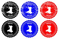 Wales rubber stamp. Wales - rubber stamp - vector, Wales map pattern - sticker - black, blue and red Stock Illustration