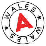 Wales stamp rubber grunge Stock Images