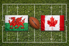Wales vs. Canada flags on rugby field Stock Photo