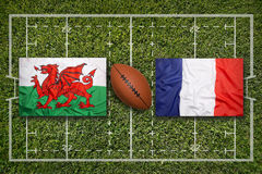 Wales vs. France flags on rugby field Stock Photos