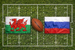 Wales vs. Russia flags on rugby field Royalty Free Stock Photo