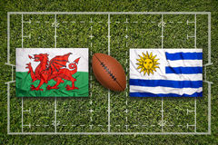 Wales vs. Uruguay flags on rugby field Stock Image