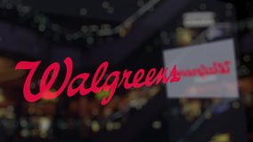 Walgreens logo on the glass against blurred business center. Editorial 3D rendering Royalty Free Stock Photos