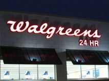 Walgreens sign on the wall in Edison on Rt 1 at late evening, NJ USA. Royalty Free Stock Photo