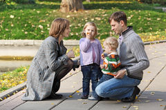 Walk. Young family with two children walk in the autumn park Stock Image
