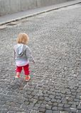 Walk. Small baby girl in the walk on city street Royalty Free Stock Photography