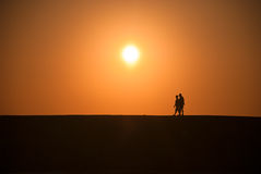 Walk. Two walking man during a sunset Stock Photo