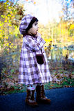 The walk. Two year old walking on a path with beautiful fall colors in the background Royalty Free Stock Photo