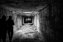 Walk through abandoned tunnel stock photography