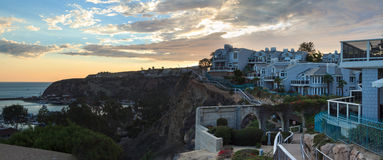 Walk above the Dana Point Harbor at sunset Stock Photo