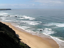 Walk alone. Lonely beach in the west coast of Portugal Stock Photo