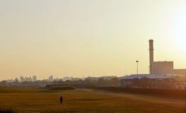 Walk alone. A man walk alone under the sunset Royalty Free Stock Photography