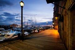 Walk along Boston Harbor. Pre-dawn light on the Boston harbor walk by Long Wharf royalty free stock image