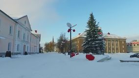 Walk along the city covered with snow. Trees and buildings covered by snow at winter day. Sunny winter day. stock video