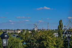 View of the shipyard. High gantry cranes against a blue September sky. stock image
