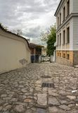 A walk along the cobbled streets of the Old Town of Plovdiv. In the distance you can see the modern city. royalty free stock photos