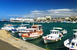 The walk along the harbor of Heraklion with ruins of Venetian era buildings and numerous yachts and boats in port, Crete. The walk along harbor of Heraklion with royalty free stock images