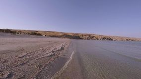 Walk along the sea surf line. First-person view. HD stock video footage