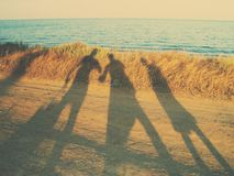 Walk along the seashore. Shadows Stock Photography
