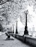 Walk along the Thames in London. Walkway along the Thames in London on a cold morning Stock Photography