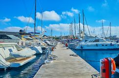 The shipyard of Valletta, Malta. The walk along the wooden shipyard with a view on luxury sailing yachts, moored on both sides, Valletta, Malta Royalty Free Stock Photography