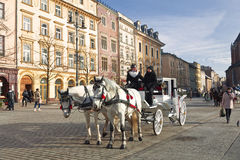 Walk around Krakow in carriages Stock Photos