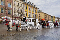 Walk around Krakow in carriages drawn by horses, Royalty Free Stock Images