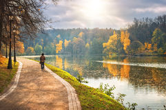 Walk in the autumn. Golden autumn in the city park near the river and grandmother for a walk Royalty Free Stock Photos
