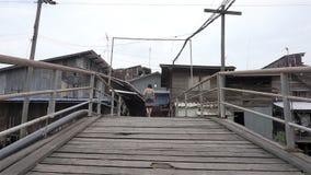 Walk away crossing the wooden bridge