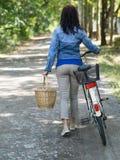 Walk away with cycle stock image