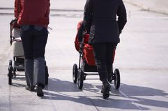 Walk with baby carriage royalty free stock image