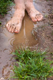 Walk barefoot through the puddles Stock Photo