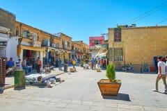 Walk Bazar-e No, Shiraz, Iran. SHIRAZ, IRAN - OCTOBER 14, 2017: The day activity in the shabby street of Bazar-e No, full of small stalls, teahouses, workshops royalty free stock photo