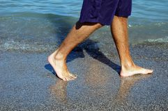 Walk on beach Stock Photo