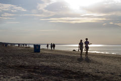 Walk at the Beach. At the beach in, summer time, nice silhouettes Royalty Free Stock Images