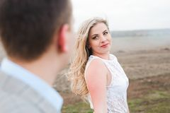 Walk the beautiful wedding couple outdoors in spring stock images