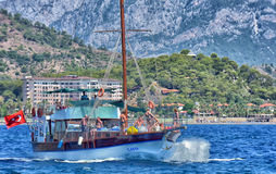 Walk on a beautiful yacht in  sea with mountains in the background Stock Photos