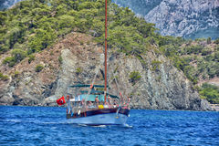 Walk on a beautiful yacht in  sea with mountains in the background Royalty Free Stock Photos