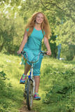 Walk on a bicycle Royalty Free Stock Photography