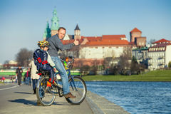 Walk on bike. Father with son cycling in city Royalty Free Stock Photography