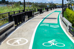 Walk and bike lane. Signs for bicycle and walking painted on the Royalty Free Stock Photography