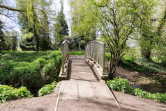 A walk bridge over a stream Stock Photos