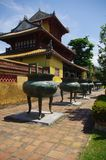 Walk of bronze bowls. A row of bronze bowls in the imperial city of Hue in central Vietnam. The bronze bowls are well preserved. It symbolizes for da dynasty Stock Photos