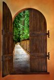 A walk in the cedars. Old world doorway to a serene walk in the forest Royalty Free Stock Photography