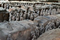 Walk closer to the TerraCotta Warriors in Xi`An, China. It`s a t. Omb complex that buried the first Emperor of China. The figures include warriors, chariots, and royalty free stock image