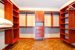 Walk-in closet in bathroom. With carpet floor and plenty of shelves stock images