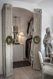 Walk in closet. Decorative dressing table with a lamp antic french ccandlestick French stock image